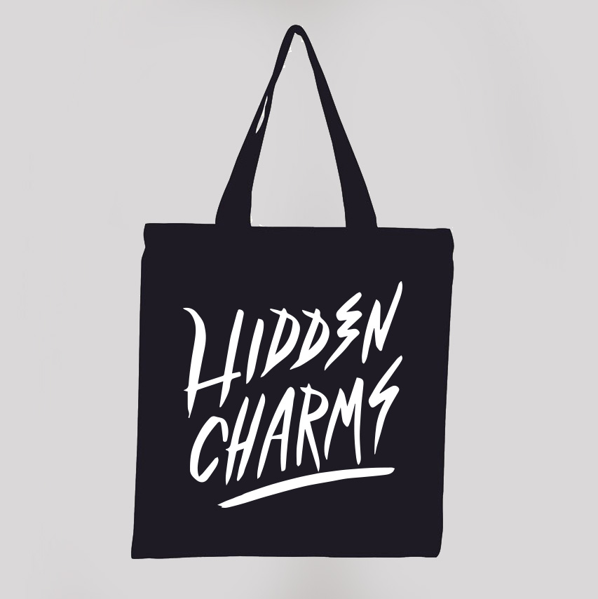 Hidden Charms black tote bag - Hidden Charms